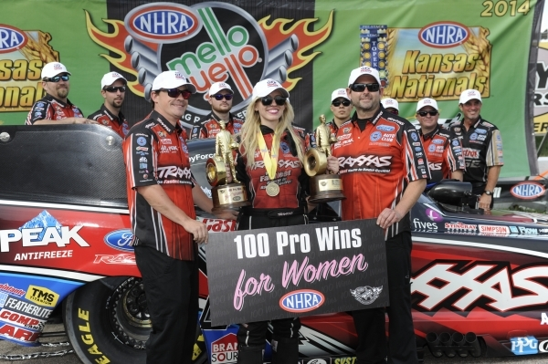 NHRA Funny Car driver Courtney Force and her crew celebrate the 100th NHRA victory by a woman, in Topeka, Kan. during 2014. Courtesy