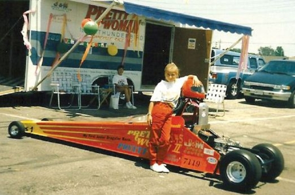 Leah Pritchett poses in front of her NHRA junior dragster when she was a youngster. Pritchett started racing junior dragsters when she was 8 years old and said the starter series has given young g ...