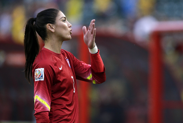 Jun 22, 2015; Edmonton, Alberta, CAN; United States goalkeeper Hope Solo (1) waves to fans after beating Colombia during the second half in the round of sixteen in the FIFA 2015 women's Worl ...