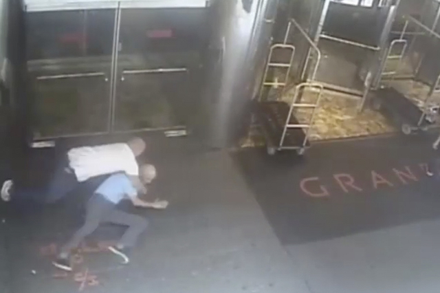 Ex-tennis star James Blake is shown tackled by a NYPD officer James Frascatore (L) in front of the Grand Hyatt hotel in New York on September 9, 2015 in this still image from a security camera vid ...