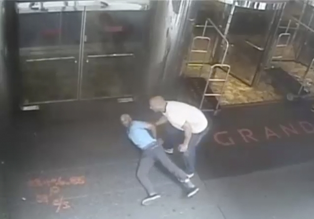 Ex-tennis star James Blake is shown handcuffed by a NYPD officer James Frascatore (R) in front of the Grand Hyatt hotel in New York on September 9, 2015 in this still image from a security camera  ...