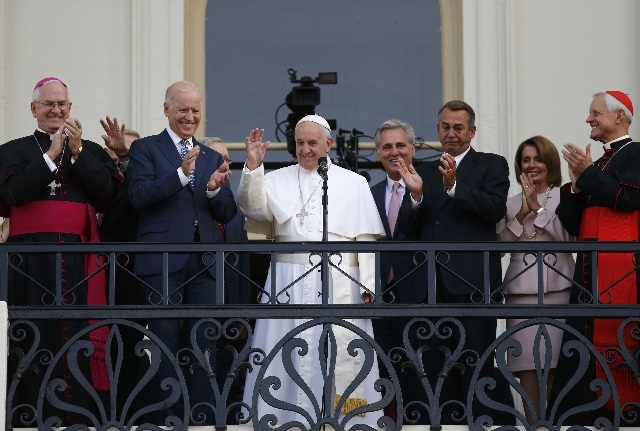 Pope Francis waves to a crowd from the Speaker's Balcony on the West Front of the Capitol as he stands with Vice President Joe Biden (2nd L), House Majority Leader Kevin McCarthy (4th from R ...