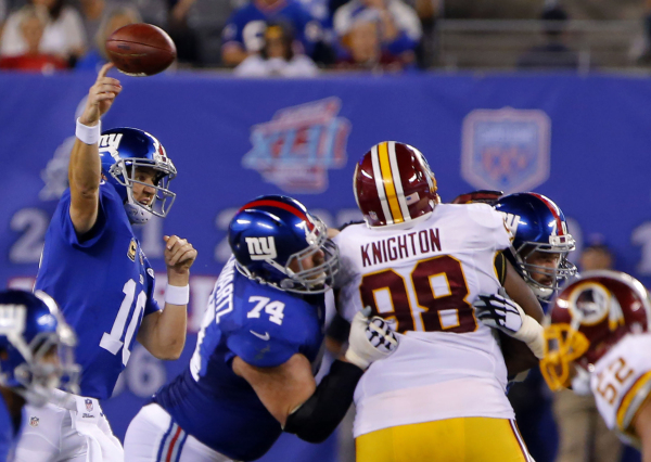 Sep 24, 2015; East Rutherford, NJ, USA; New York Giants quarterback Eli Manning (10) passes over Washington Redskins during second half at MetLife Stadium. The New York Giants defeated the Washing ...