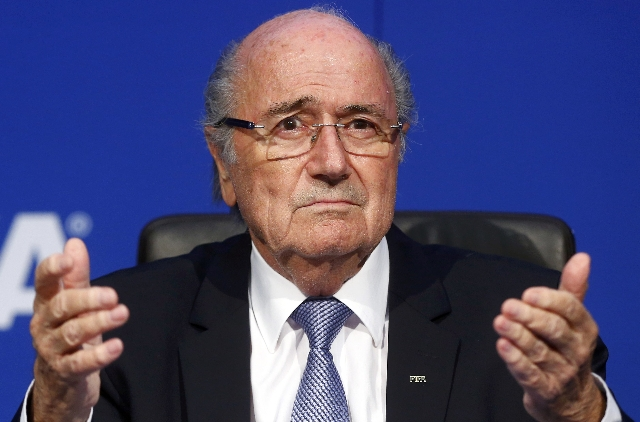 FIFA President Sepp Blatter reacts during a news conference after the Extraordinary FIFA Executive Committee Meeting at the FIFA headquarters in Zurich, Switzerland, in this July 20, 2015 file pho ...