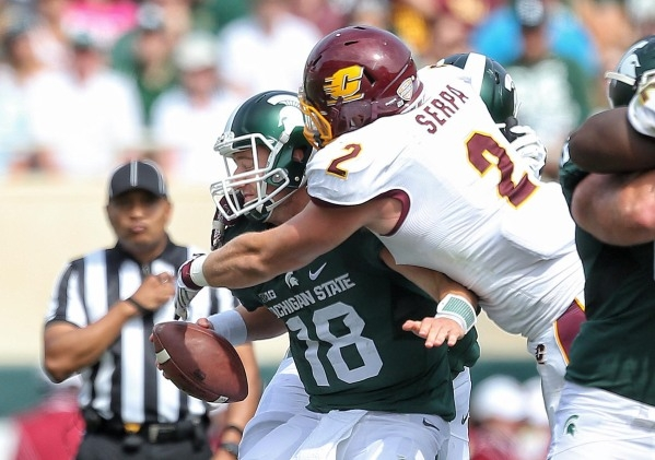 Sep 26, 2015; East Lansing, MI, USA; Michigan State Spartans quarterback Connor Cook (18) is sacked by Central Michigan Chippewas defensive lineman Blake Serpa (2) during the 2nd half of a game at ...