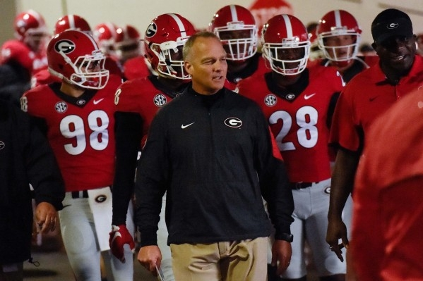 Sep 26, 2015; Athens, GA, USA; Georgia Bulldogs head coach Mark Richt leads his players on to the field prior to the game  against the Southern University Jaguars at Sanford Stadium. Georgia defea ...