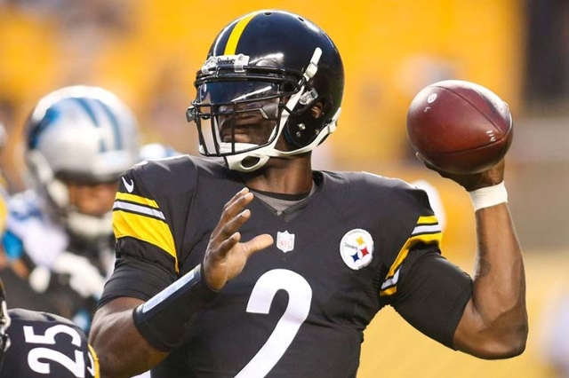 Sep 3, 2015; Pittsburgh, PA, USA; Pittsburgh Steelers quarterback Michael Vick (2) looks to pass against the Carolina Panthers during the first quarter at Heinz Field. (Charles LeClaire/USA Today  ...