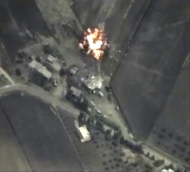 A frame grab taken from footage released by Russia's Defence Ministry September 30, 2015, shows precise airstrikes carried out by the country's air force on Wednesday, against Islamic  ...