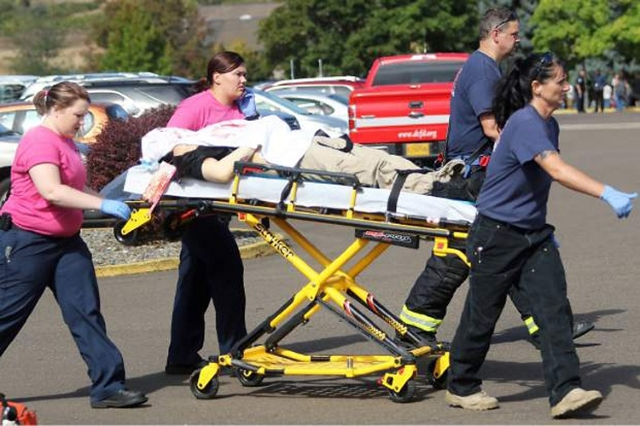 First responders transport an injured person following a shooting incident at Umpqua Community College in Roseburg, Oregon October 1, 2015. (Reuters/Michael Sullivan/The News-Review)