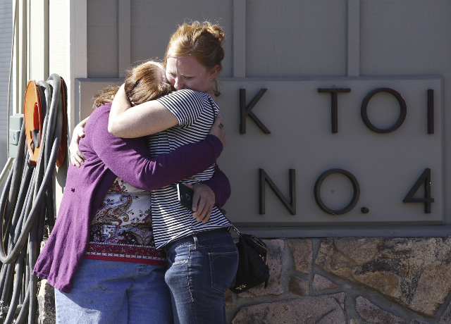Umpqua Community College alumnus Donice Smith (L) is embraced after she said one of her former teachers was shot dead, near the site of a mass shooting at Umpqua Community College in Roseburg, Ore ...