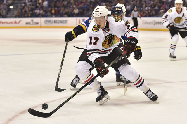 Oct 1, 2015; St. Louis, MO, USA; Chicago Blackhawks defenseman Ville Pokka (17) controls the puck against the St. Louis Blues during the second period at Scottrade Center. (Jasen Vinlove/USA Today ...