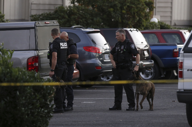 Police investigators are seen following a mass shooting at Umpqua Community College in Roseburg, Oregon October 1, 2015. A gunman opened fire at a community college in southwest Oregon on Thursday ...