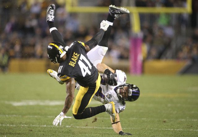 Oct 1, 2015; Pittsburgh, PA, USA; Pittsburgh Steelers cornerback Antwon Blake (41) up-ends Baltimore Ravens fullback Kyle Juszczyk (44) during the third quarter at Heinz Field. The Ravens won 23-2 ...