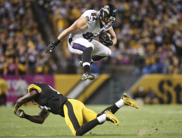Oct 1, 2015; Pittsburgh, PA, USA; Baltimore Ravens tight end Nick Boyle (82) jumps over Pittsburgh Steelers inside linebacker Lawrence Timmons (bottom) during the third quarter at Heinz Field. The ...