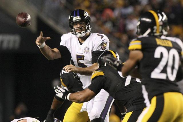 Oct 1, 2015; Pittsburgh, PA, USA; Baltimore Ravens quarterback Joe Flacco (5) throws the ball under pressure from the Pittsburgh Steelers defense during the second half at Heinz Field. The Ravens  ...
