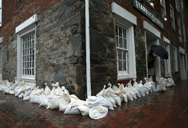 A patron departs from a Starbucks that is fortified with sandbags in Alexandria, Virginia October 2, 2015. Powerful Hurricane Joaquin, which battered the Bahamas with torrential rain, powerful win ...