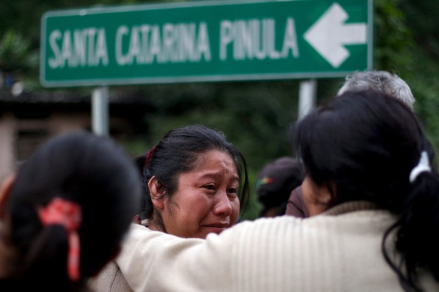 A resident reacts after a landslide destroyed her house in Santa Catarina Pinula, on the outskirts of Guatemala City, October 2, 2015. REUTERS/Josue Decavele