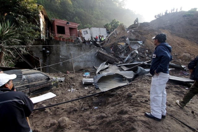 A resident looks at houses damaged by a landslide in Santa Catarina Pinula, on the outskirts of Guatemala City, October 2, 2015. REUTERS/Josue Decavele