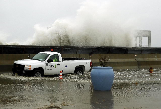 Waves crash over the sea wall as a truck drives down a flooded street as a nor'easter comes on shore in Atlantic City, New Jersey, October 2, 2015. Powerful Hurricane Joaquin, which battered the ...