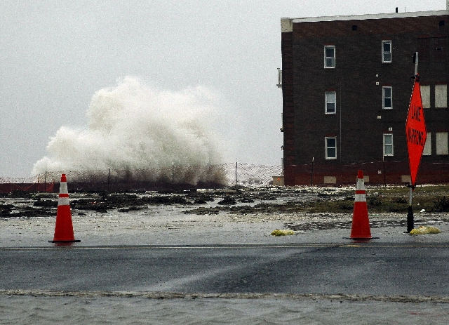 Waves crash against the sea wall in front of an apartment building as a nor'easter comes on shore in Atlantic City, New Jersey, October 2, 2015. Powerful Hurricane Joaquin, which battered the Ba ...