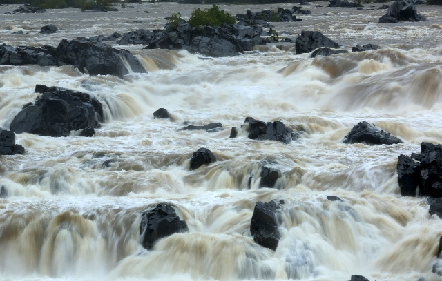 The Potomac River surges over Great Falls in Virginia October 2, 2015. Powerful Hurricane Joaquin, which battered the Bahamas with torrential rain, powerful winds and storm surges on Thursday, is  ...