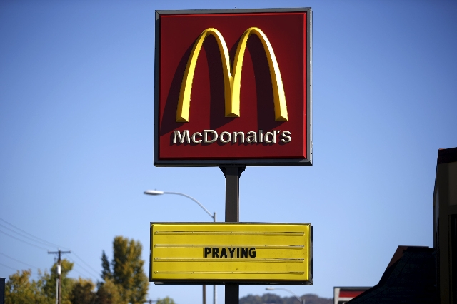 A McDonald's restaurant sign offers support to the families of the Umpqua Community College shooting victims in Roseburg, Oregon, United States, October 2, 2015. The Oregon gunman who carrie ...