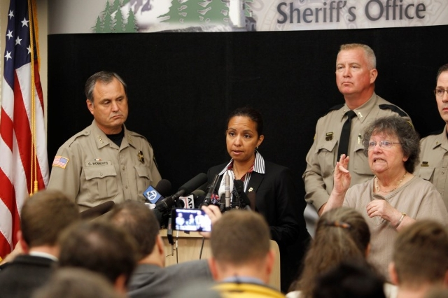 Celinez Nunez, assistant special agent of U.S. Bureau of Alcohol, Tobacco, Firearms and Explosives Agent (C) speaks at a news conference in Roseburg, Oregon October 2, 2015.  REUTERS/Steve Dipaola
