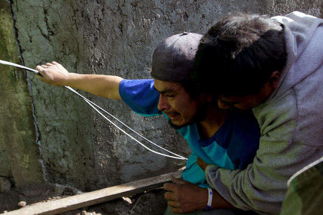 A relative of a mudslide victim is comforted by a friend in Santa Catarina Pinula, on the outskirts of Guatemala City, October 2, 2015. Hundreds of rescue workers dug through sludge and rock on Fr ...