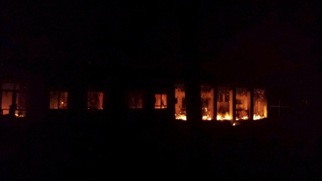 Fire is seen inside a Medecins Sans Frontieres (MSF) hospital building after an air strike in the city of Kunduz, Afghanistan in this October 3, 2015 MSF handout photo. (Medecins Sans Frontieres/R ...