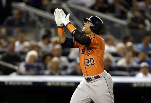 Oct 6, 2015; Bronx, NY, USA; Houston Astros center fielder Carlos Gomez (30) celebrates after hitting a solo home run against the New York Yankees during the fourth inning in the American League W ...