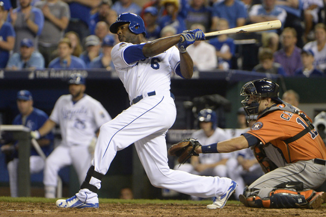 Oct 8, 2015; Kansas City, MO, USA; Kansas City Royals center fielder Lorenzo Cain hits a single against the Houston Astros in the 8th inning in game one of the ALDS at Kauffman Stadium. (John Rieg ...