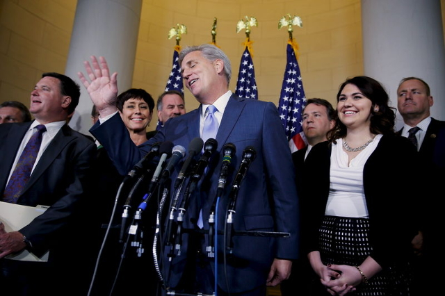 U.S. House Majority Leader Kevin McCarthy laughs off a question as he explains his decision to pull out of a Republican caucus secret ballot vote to determine the nominee to replace retiring House ...