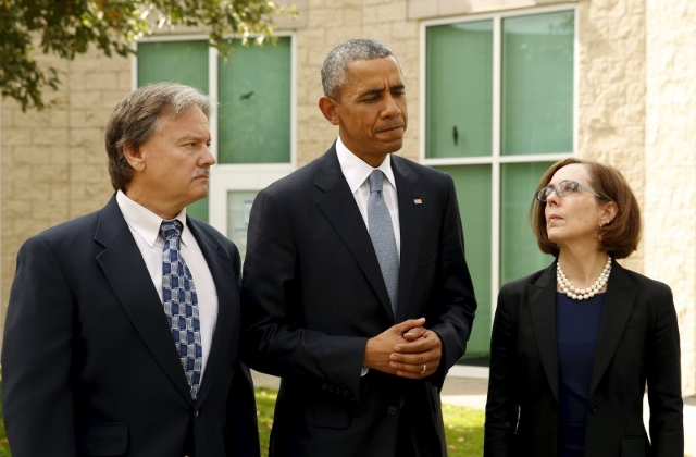 U.S. President Barack Obama speaks immediately after meeting with families of victims of the shooting rampage in Roseburg, Oregon October 9, 2015.  Flanking Obama are Rosberg Mayor Larry Rich and  ...