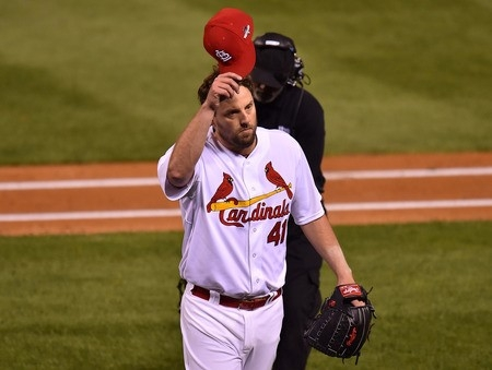Oct 9, 2015; St. Louis, MO, USA; St. Louis Cardinals starting pitcher John Lackey (41) waves to fans after being pulled in the eighth inning of game one of the NLDS against the Chicago Cubs at Bus ...