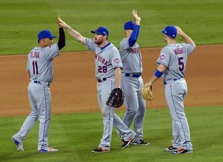 October 9, 2015; Los Angeles, CA, USA; New York Mets second baseman Kelly Johnson (55), second baseman Daniel Murphy (28) and third baseman David Wright (5) celebrate the 3-1 victory against the L ...
