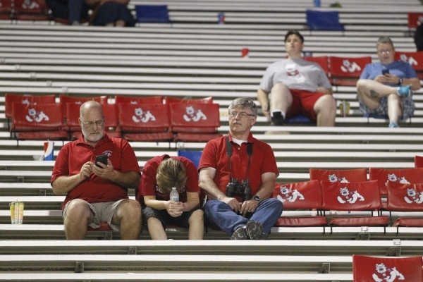 Oct 10, 2015; Fresno, CA, USA; Fresno State Bulldogs fans sit in the stands during action against the Utah State Aggies in the fourth quarter at Bulldog Stadium. The Aggies defeated the Bulldogs 5 ...
