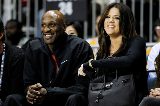 Los Angeles Lakers' Lamar Odom and his wife television personality Khloe Kardashian sit courtside as they attend the 2011 BBVA All-Star Celebrity basketball game as a part of the NBA All-Sta ...