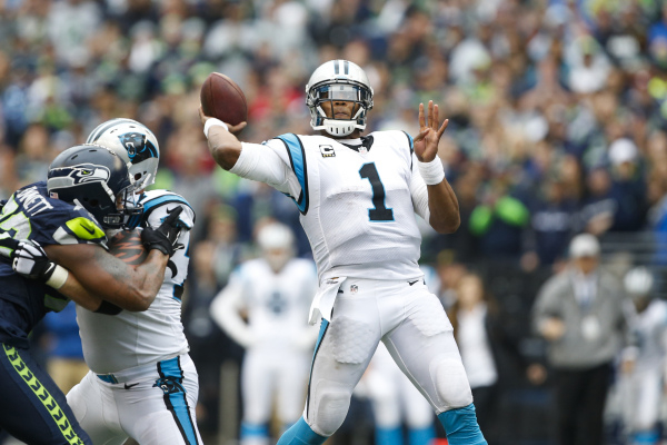 Oct 18, 2015; Seattle, WA, USA; Carolina Panthers quarterback Cam Newton (1) throws a 26-yard touchdown pass against the Seattle Seahawks during the fourth quarter at CenturyLink Field. Carolina d ...