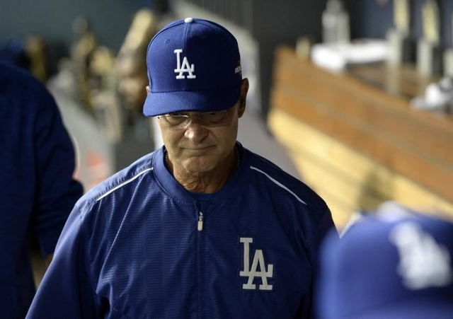 Los Angeles Dodgers manager Don Mattingly (8) reacts following the 3-2 loss against New York Mets in game five of NLDS at Dodger Stadium in Los Angeles, Oct. 15, 2015. (Jayne-Kamin Oncea-USA TODAY ...