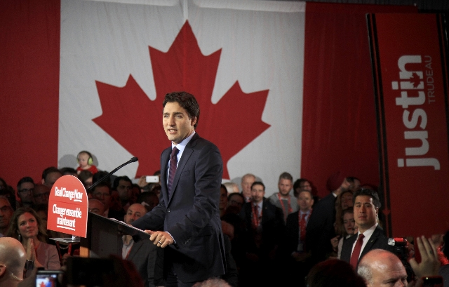 Liberal Party leader Justin Trudeau gives his victory speech after Canada's federal election in Montreal, Quebec, October 19, 2015.  REUTERS/Christinne Muschi