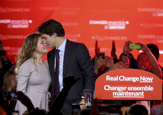 Liberal Party leader Justin Trudeau shares a moment with his wife Sophie Gregoire as he gives his victory speech after Canada's federal election in Montreal, Quebec, October 19, 2015.      R ...