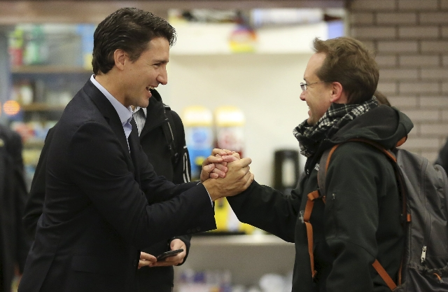 Liberal leader and prime minister-designate Justin Trudeau greets people at a subway station in his riding in Montreal, Quebec, October 20, 2015.  REUTERS/Chris Wattie