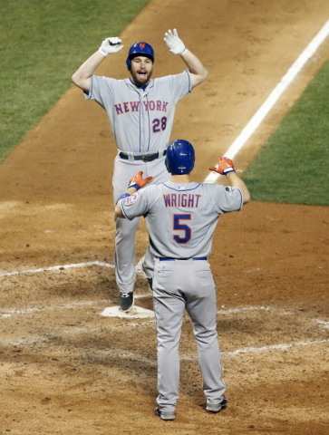 October 20, 2015; Chicago, IL, USA; New York Mets second baseman Daniel Murphy (28) celebrates with third baseman David Wright (5) his two run home run in the eighth inning against the Chicago Cub ...