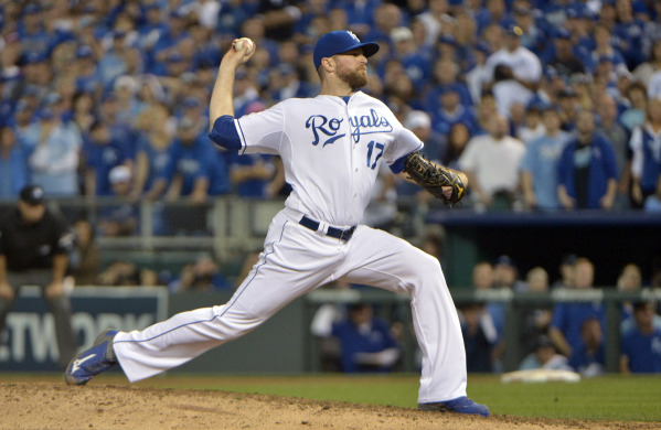 Oct 23, 2015; Kansas City, MO, USA; Kansas City Royals relief pitcher Wade Davis throws a pitch against the Toronto Blue Jays in the 8th inning in game six of the ALCS at Kauffman Stadium. Mandato ...