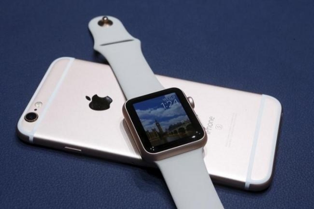 A new Apple iPhone 6S and Apple Watch in the new matching rose gold color are displayed during an Apple media event in San Francisco, California, September 9, 2015. (Reuters/Beck Diefenbach)