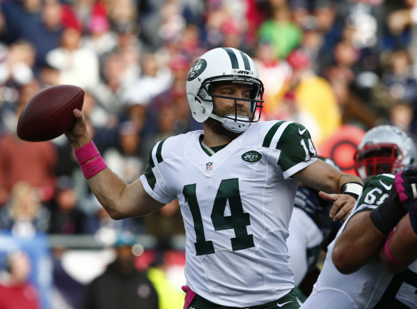 Oct 25, 2015; Foxborough, MA, USA; New York Jets quarterback Ryan Fitzpatrick (14) throws a pass against the New England Patriots during the second half at Gillette Stadium. Mandatory Credit: Mark ...
