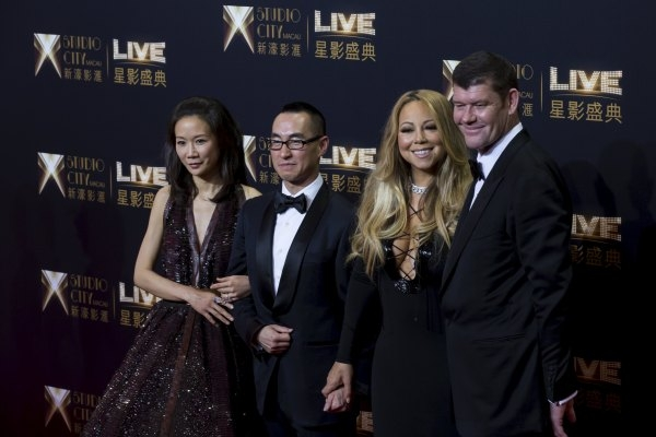 Lawrence Ho (2nd-L), chief executive officer of Melco Crown Entertainment, his wife Sharon, singer Mariah Carey (2nd-R) and Australian billionaire James Packer (R), co-chairman of Melco Crown Ente ...