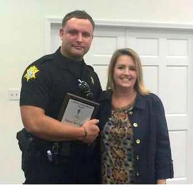 Richland County Sheriff's Department Officer Senior Deputy Ben Fields is pictured with Karen Beaman, principal of Lonnie B. Nelson Elementary School, after receiving the Culture of Excellenc ...
