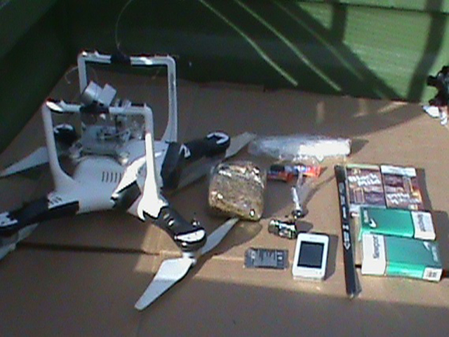 A drone that was carrying a package that contained two hacksaw blades, drugs, a cellphone and more crashed onto the grounds of an Oklahoma prison. (Oklahoma Department of Corrections/Reuters) on M ...