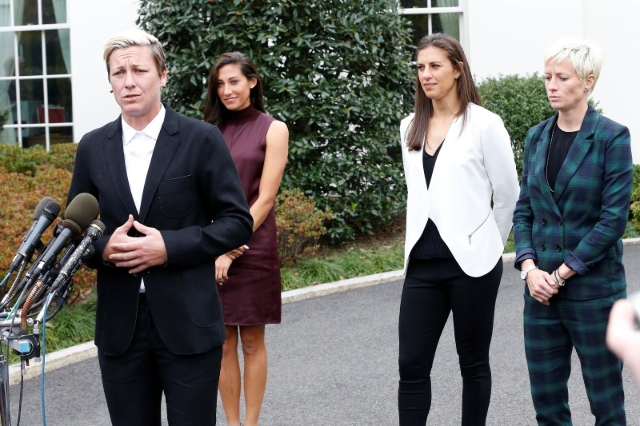 Oct 27, 2015; Washington, DC, USA; (L-R) Team USA forward Abby Wambach speaks with the media at the stakeout position outside the West Wing as Team USA forward Christen Press, Team USA midfielder  ...
